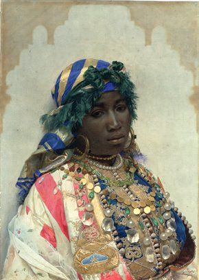 """José Tapiro y Baro 1836-1913  """"A Tangerian Beauty""""  Watercolor  26 x 18 1/2""""  A result of time spent in Tangier,  Moroccan city,  Tapiró Baró painted many Orientalist images.  In this vivid watercolor, the silken gleam of the headscarf - the glint of gold - the glow of pearls - the close study of her face contribute to the remarkable immediacy of the work.  It contains the number 1309 - probably refers to Muslim calendar – Hegira - began - 622 AD.  Date = about 1891 AD in Gregorian calendar"""