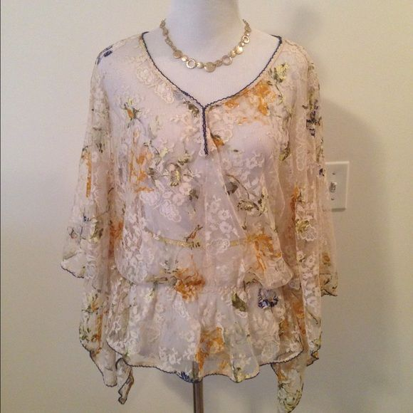 Free People Sheer Lace Batwing Top Absolutely gorgeous top from Free People. Pics don't do this one justice. Sheer and lacy, in soft neutral tones of cream and gold, with batwing sleeves and an elastic waistband. Size medium. NWOT. ❌ NO TRADES ❌ NO PP❌ NO LOWBALLING ❌ Free People Tops