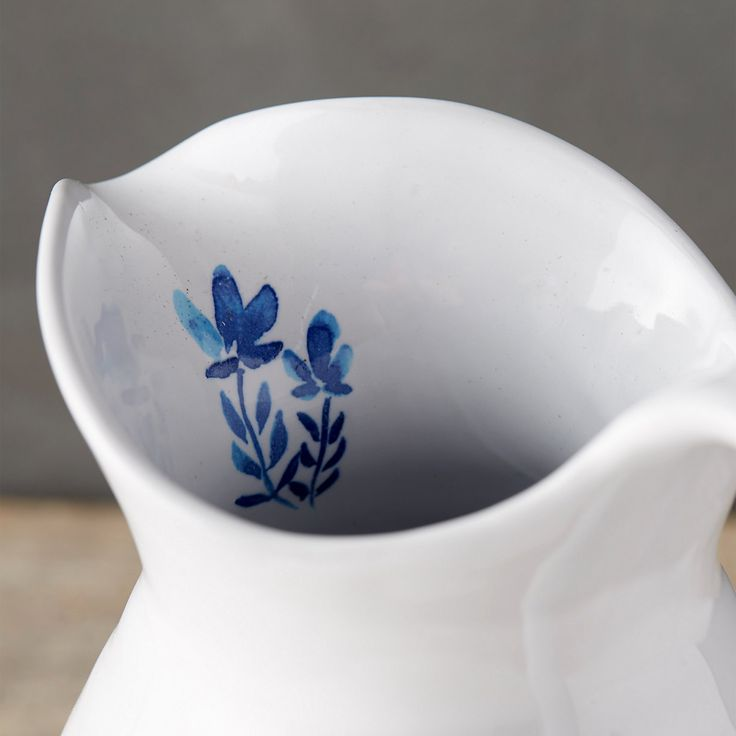 Hand-crafted exclusively for terrain from glazed stoneware, this traditional pitcher is finished with a delicate sketch of blooming stems.- A terrain