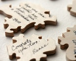 could be a cool way of having people write their wishes for bride/groom and then could frame the finished puzzle :)