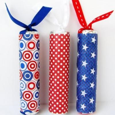 Wrap lifesaver candies with patriotic ribbon and paper to create a fun firework treat.  Perfect for decoration your table for your patriotic celebration or as a party favor for your guests, these treats are a great craft for the kids to help create.