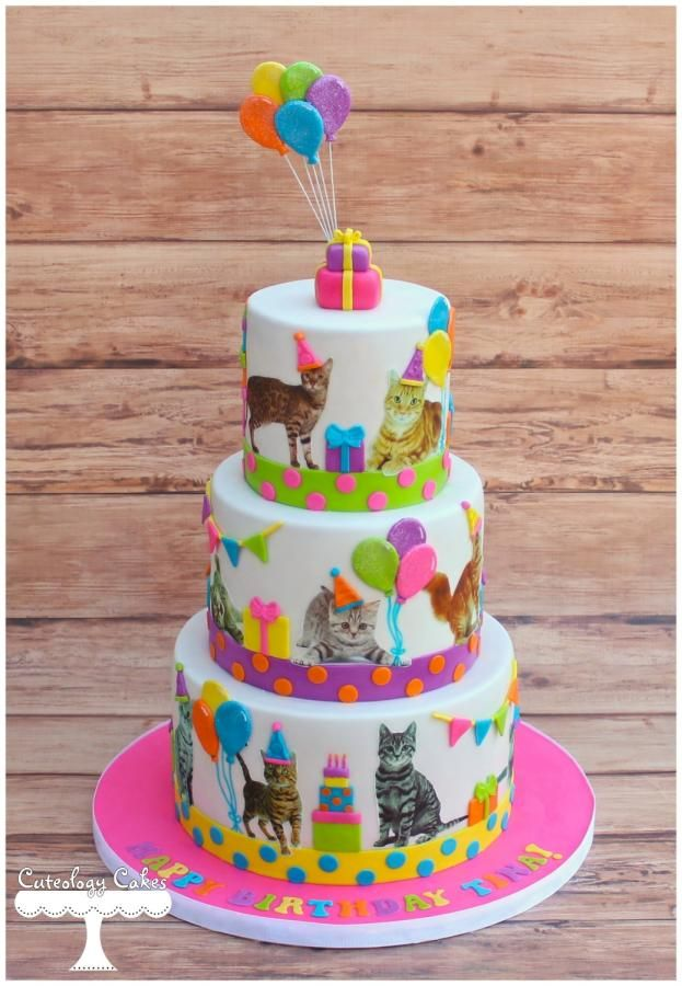 This cake still cracks me up. I used edible images of cats and fondant details to make this cake. :)