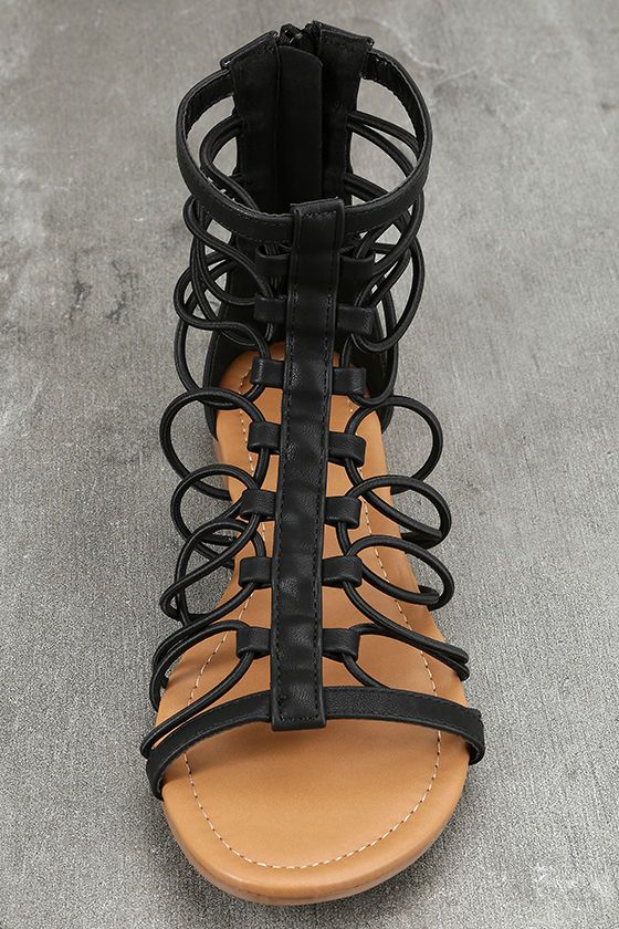 "The Jora Black Gladiator Sandals are versatile, comfy, and ready for a festival! Black vegan leather straps loop atop a peep-toe upper to a cute, gladiator silhouette. 4.5"" heel zipper."