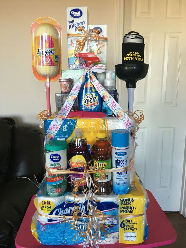 House warming gift with some personal touches for the couple. You can never go wrong with cleaning supplies, toilet paper, and paper towels