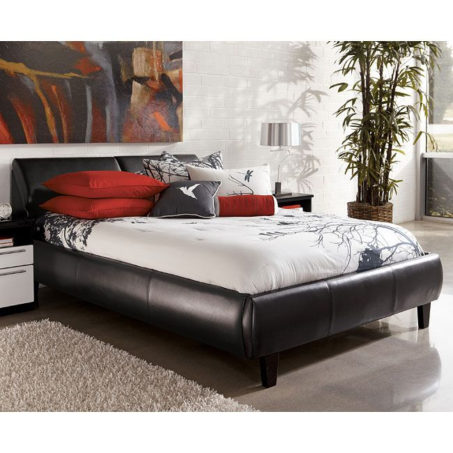 The Two Toned High Gloss Black And White Finish Of The Piroska Bedroom Collection By Millennium