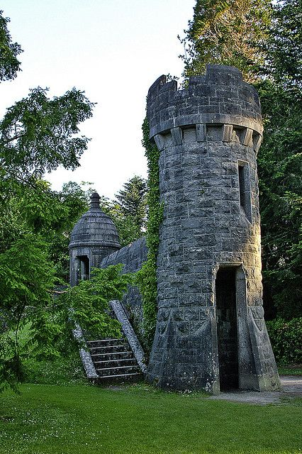 Towers in the Garden of Ashford Castle, Cong, Mayo, Ireland.  Ashford Castle is a medieval castle turned 5-star luxury hotel.  by HangtownGal