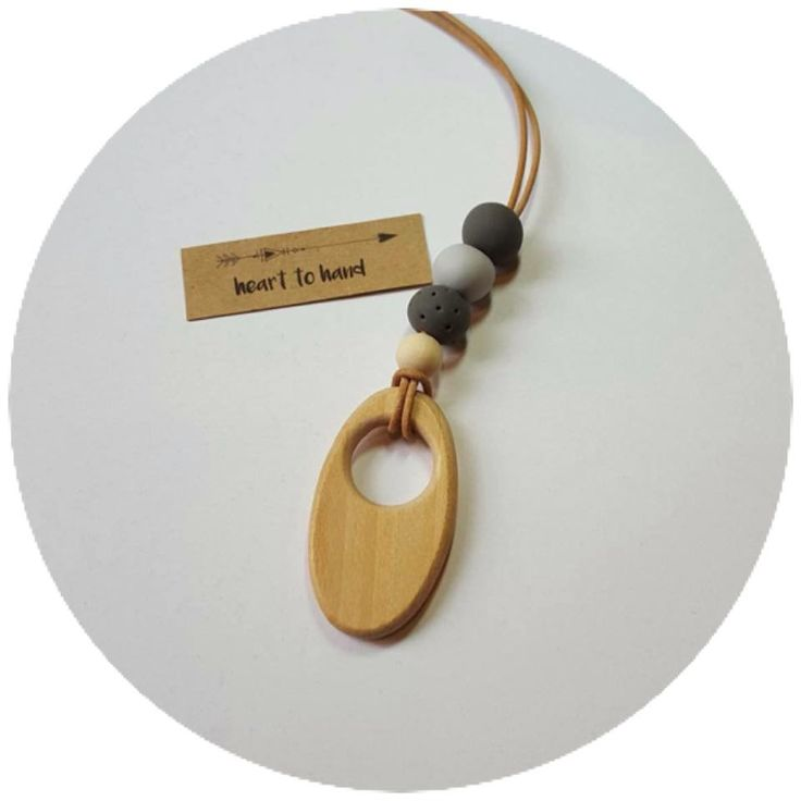 Clay beads on natural leather. Length approx 88cm. This necklace also features a unique raw wooden bead.
