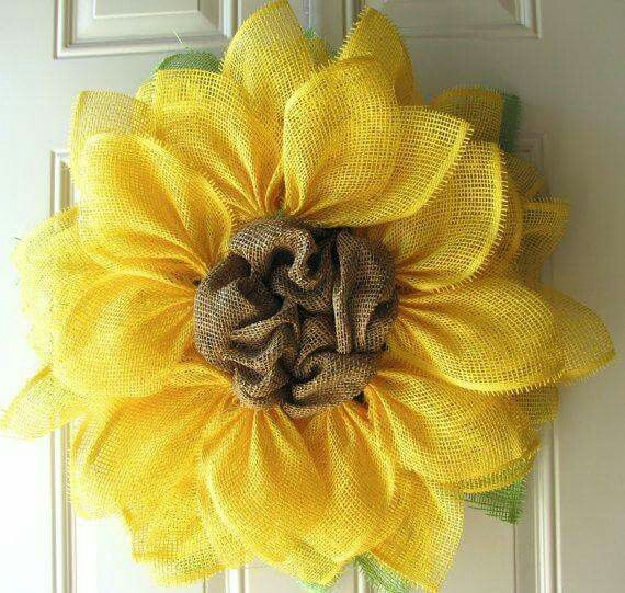 Beautiful Sunflower Wreath!  Might have to make one this summer! http://www.trendytree.com/blog/yellow-paper-flower-tutorial/?hc_location=ufi