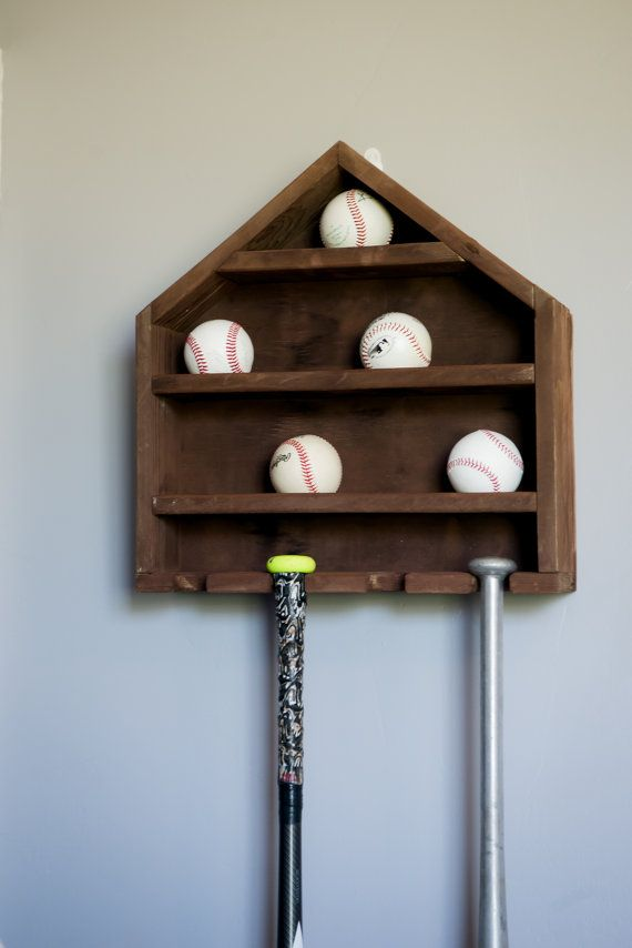 What better way to display those home run balls or those balls signed by famous players? Whether its a baseball themed room or just your living room, this baseball display is a great way of letting people see your special baseballs. This baseball holder is complete with 9 spaces for balls and 4 spaces for baseball bats. The home plate display is made from pallet wood and put together with wood glue and a pneumatic nail gun. Baseball holes are drilled with a two inch forstner bit and the…