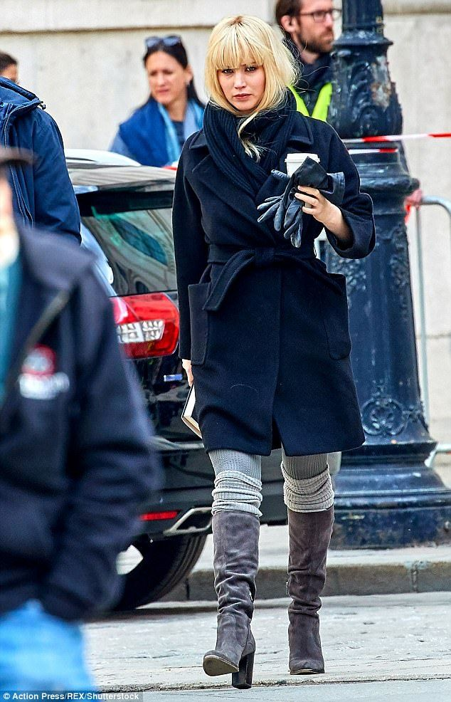 Smooth criminal! Sexy Jennifer Lawrence pulled off killer looks in knee-high boots for Russian spy role on set for new movie Red Sparrow in Vienna on Saturday