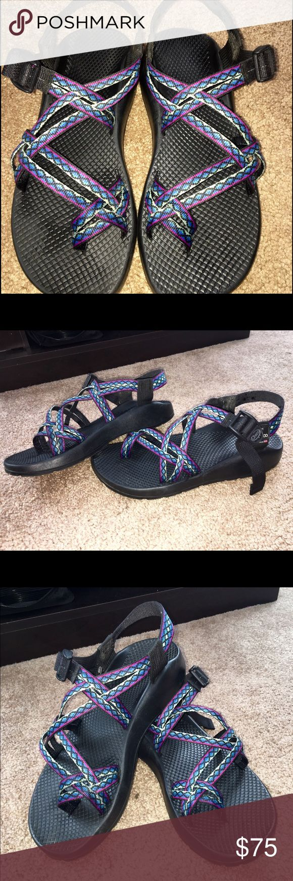 Double strap chacos with toe strap Only worn about 4 times, In great condition. Black soles with purple, blue, black, and turquoise designed straps. Chacos Shoes Sandals