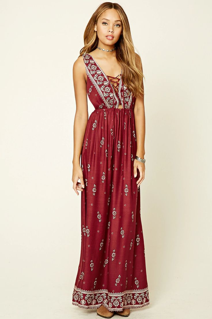 A woven maxi dress featuring a floral print, plunging lace-up neckline, V-back, sleeveless cut, and an elasticized waist.