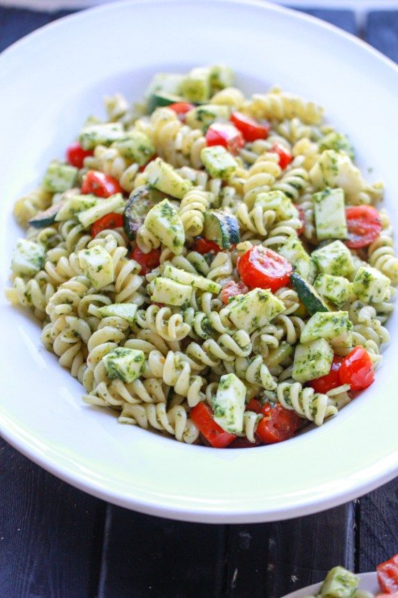 A simple nut free pesto sauce tossed with pasta, fresh mozzarella, tomatoes, and zucchini. It is the perfect side dish or main dish.