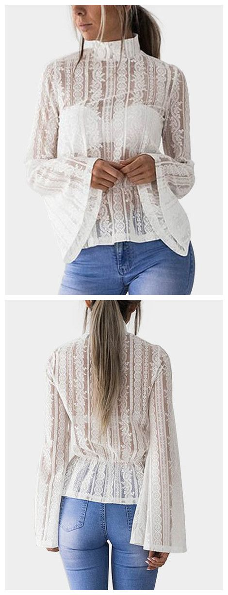 This textured sheer blouse features a modest floral lace pattern, a mock neckline, long flared sleeves, an elasticized waist, and a concealed back zipper. Going sheer doesn't have to be a hassle in this number, layer it over a neutral cami and add silver accessories for a sophisticated look.