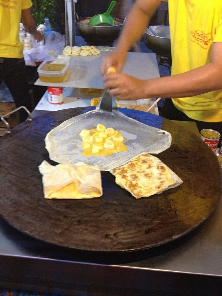Asiatique- Bangkok, Thailand. I am not sure of the name but it's similar to banana crepes