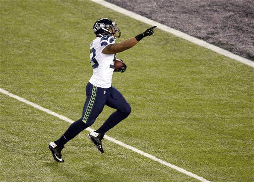 Seattle Seahawks' Malcolm Smith (53) runs back an interception for a touchdown during the first half of the NFL Super Bowl XLVIII football game against the Denver Broncos Sunday, Feb. 2, 2014, in East Rutherford, N.J. (AP Photo/Charlie Riedel)