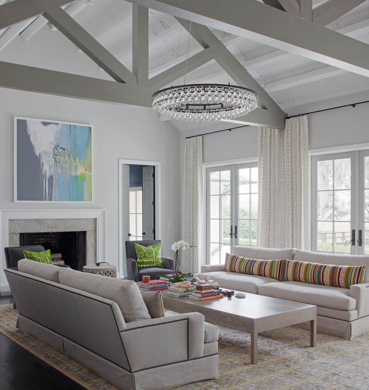 Vertical Lines Throughout This Living Roomu2014stripes On The Accent Pillows,  The Drips Of The Painting, The Curtainsu2014help Call Attention To The Roomu0027s  Soaring ...