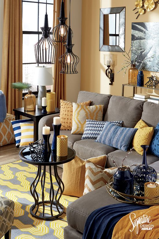 #AshleyFurniture - Looking for a new color theme for your living room? Try classic navy blue with a bright golden yellow! Mix and match these colors in pillows, throws, accessories, wall art and rugs to create your own personal style! Ashley Furniture - Blue and Yellow Living Room Ideas - Color - Accessories - Accents