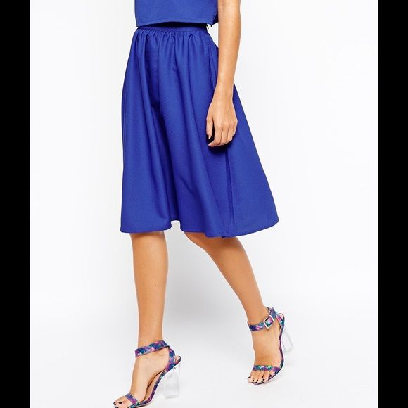 "ASOS True Decadence Full Midi Skirt Blue Petite M As seen on Extra Petite's blog!  ASOS True Decadence Midi Full skirt in Royal Blue. Please note this is a PETITE. Measurements laying flat: waist 13.5"", length 24"". There isn't any give in the waist - I'm about 5'3 1/2"" 108 lbs and it fits me me fine but this skirt runs small as extra petite describes on her blog so I ordered it in a Petite Medium. When I took pictures I noticed it says it's a Petite 10 - go figure!  Lovely skirt, worn twice…"