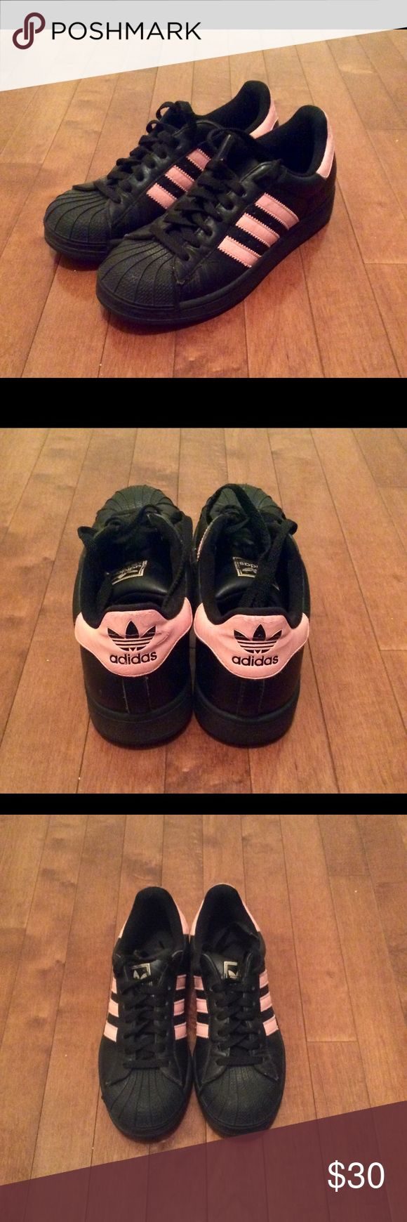Adidas sneakers Black and pink Adidas shell top sneakers. Very comfortable. There is some wear to them, but they are still in really good condition, no major gashes, tears, peeling, etc. They're a 6.5 but fit more like a 7. adidas Shoes Sneakers
