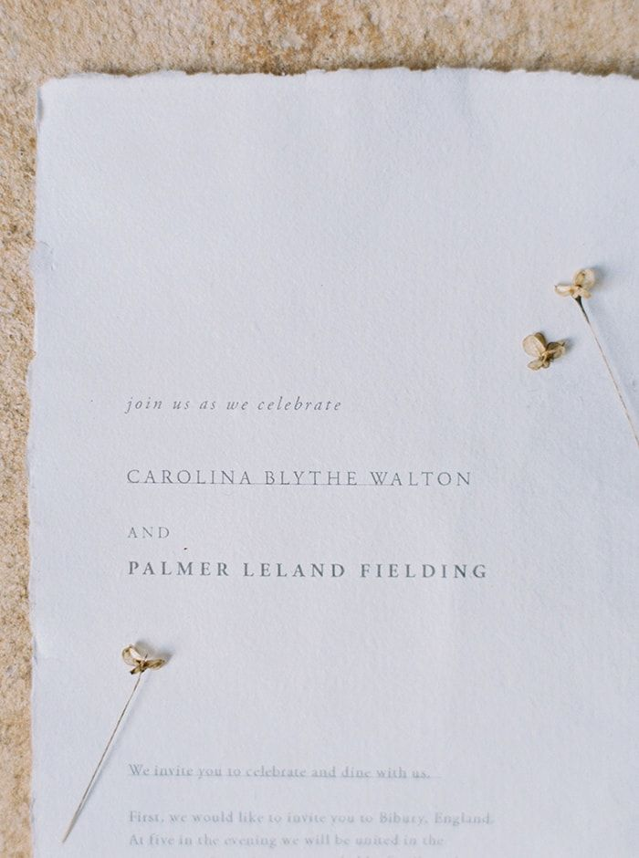 Delicate type and flower detail on an invitation.