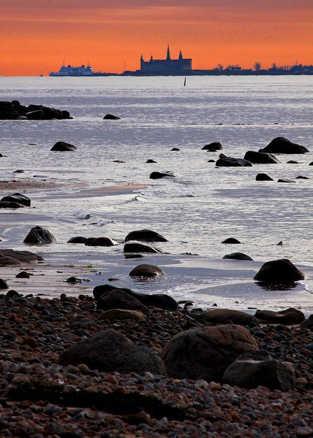 Photo from Domsten (province of Skåne, Sweden). View of the Öresund strait with the danish castle Kronborg (known as Elsinore in Shakespeare's Hamlet) at the horizon.