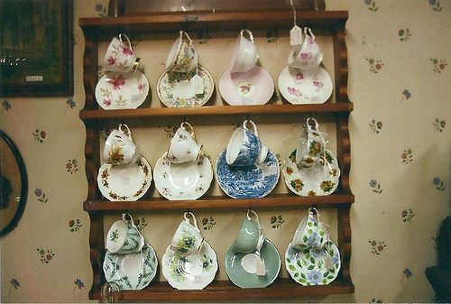 Sweet display of tea cups and saucers.