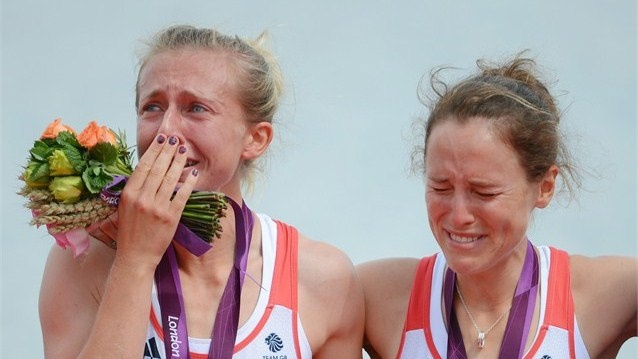 Katherine Copeland and Sophie Hosking of Great Britain celebrate with their gold medals during the medal ceremony for the women's Lightweight Double Sculls final on Day 8 of the London 2012 Olympic Games at Eton Dorney.