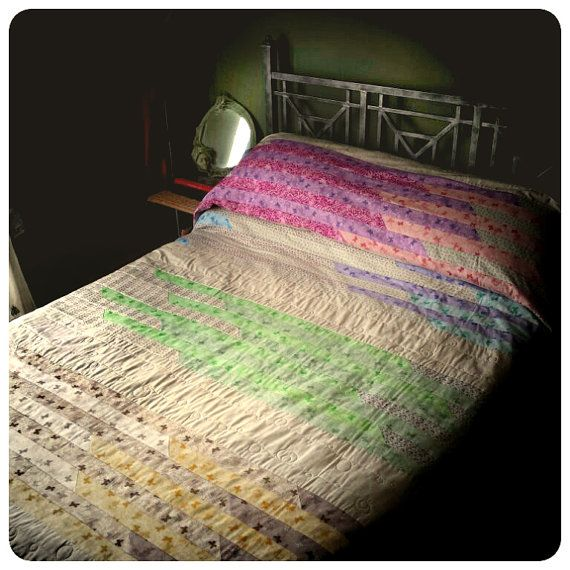 Catch a pastel rainbow with this versatile multi-coloured striped patchwork quilt from Handmade By Elaine. Custom handmade by a seasoned