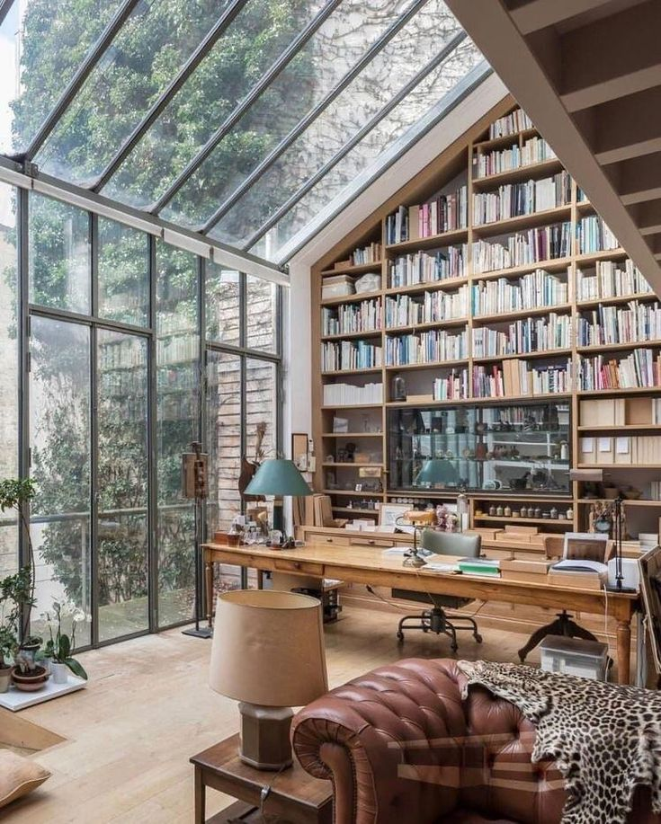Home Interior Design — Beautiful home office with books and windows.