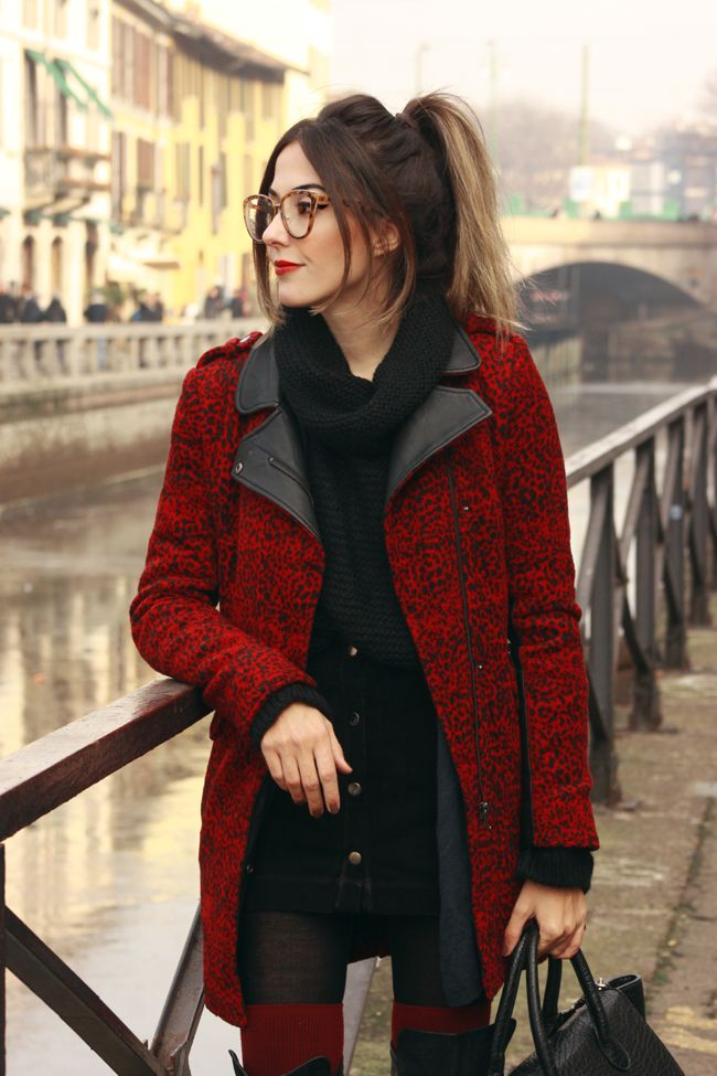 Winter outfit in Milan wearing red long coat with black jumper and button front skirt.