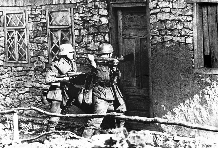 German infantrymen force their way into a snipers hide-out, where Russians had been firing upon advancing German troops, on September 1, 1941. (AP Photo)