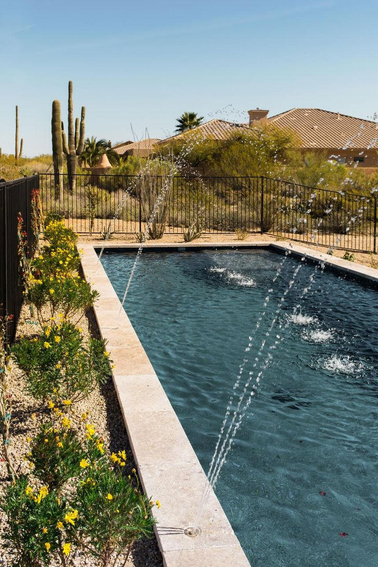 With a sparkling pool and inviting covered patio with misters for relaxing and entertaining, the well-designed backyard at HGTV Smart Home 2017 provides a comfortable and stylish way to enjoy the warm climate of this desert modern home.