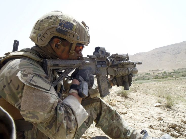 n Australian soldier from the Special Operations Task Group watches for insurgent activity during a mission in Uruzgan province, southern Afghanistan.