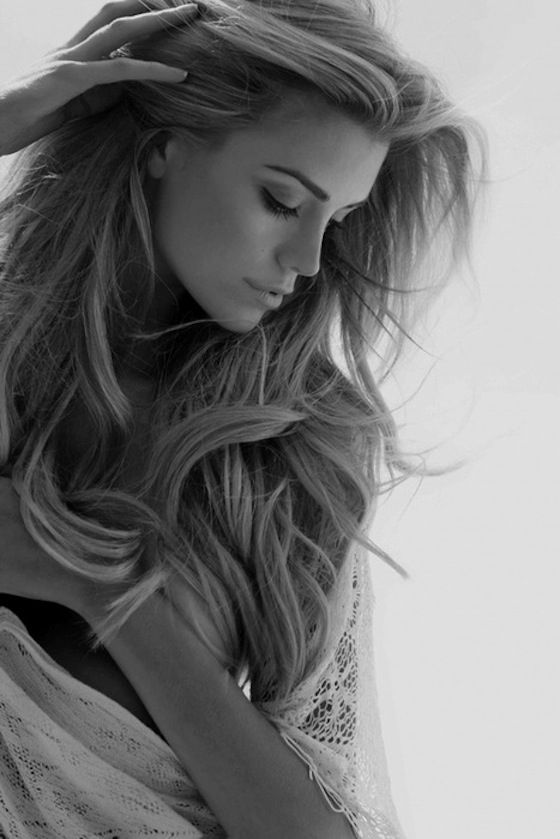 Black and White Photographs are so beautiful when they are done well. Woman long blonde tousled wavy hair portrait