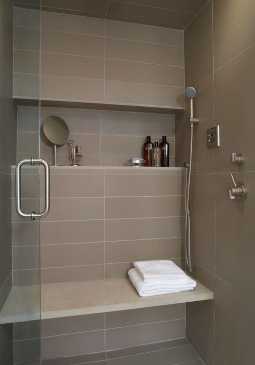 Notice the handles at lower levels, and the attachment for the hand-held shower next to the built-in bench.  Great features!