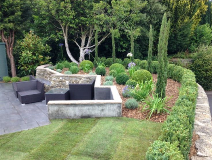 The after photo for this raised seating area. Planted by Architectural Plants