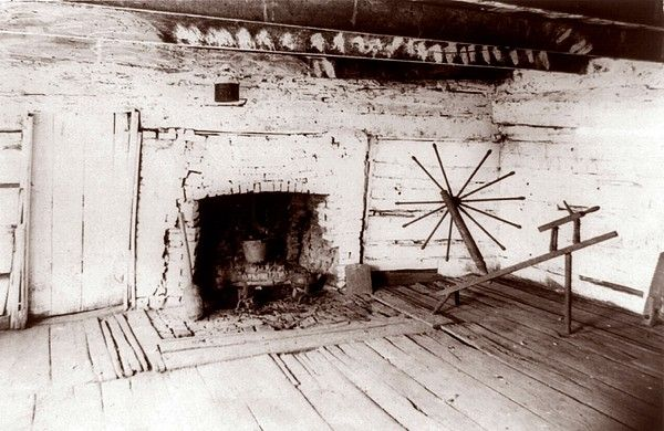 Abraham Lincoln's birthplace, a log cabin in Kentucky with fireplace and the spinning jenny of Mrs. Lincoln. 1891 photo.