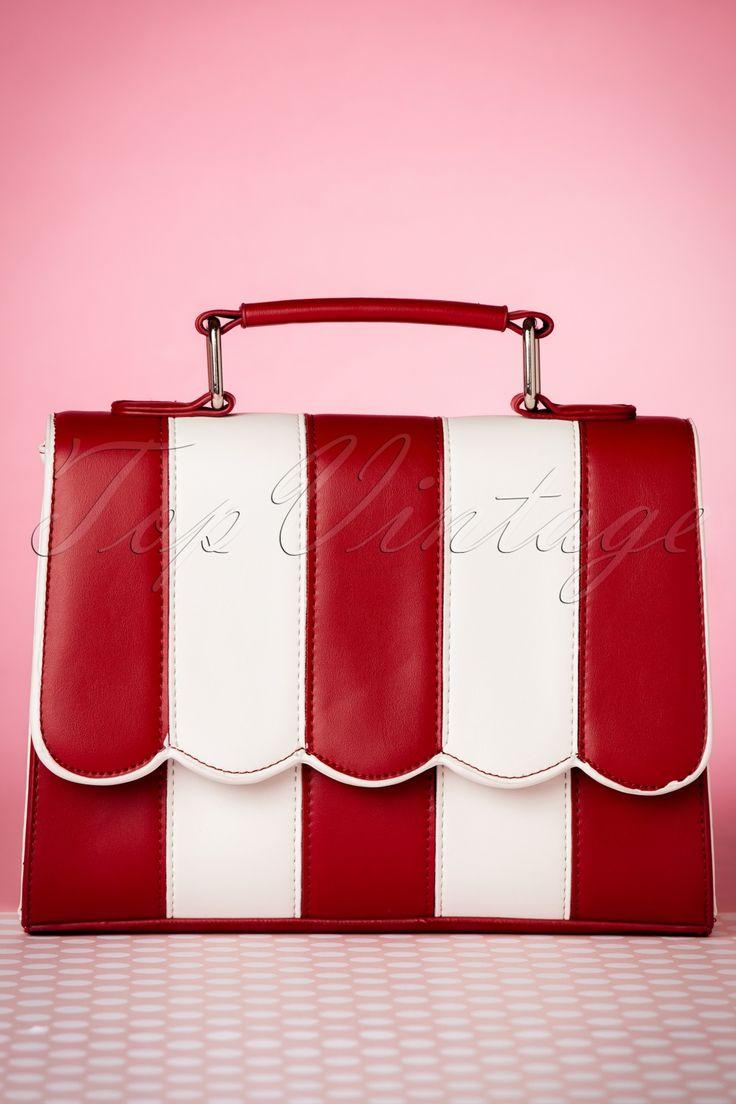 """Deze prachtige 50s Stella Striped Handbagis de perfecte match voor al jouw 50s 'diner' outfits!Jouw outfit is niet compleet zonder dit schatje... wow! Dit handtasje is uitgevoerd in rood en wit gestreept 'faux' leder met geschulpte rand langs de klep en speels handvat. """"Lets go to the diner baby!"""" ;-)   Magneet- en ritssluiting 3 extra vakjes, waarvan één met rits Zilverkleurig metaal Volledig gevoerd met zwart/wit gestr..."""