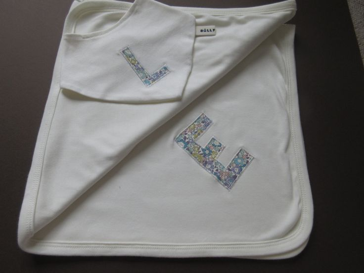 Lovely swaddling blanket with oversized embroidered initial. Choice of exclusive…