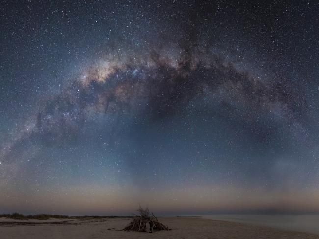 Taken at Sandy Bay, Cape Range National Park. Neal said he was camping in Cape Range, and he loved the idea of it lighting up the unlit bonfire with the night sky stars.  <b>Exposure: 30 secs, ISO 4000, f/2.8</b> Picture: Neal Pabari/distantpixels.com