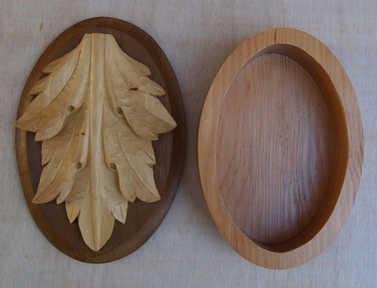 Arcanthus Leaf Box by Frank Duyker. The leaf, carved in huon pine is attached to a Spotted Gum (corymbia maculata) lid. The oval body of the box is made from Douglas Fir.