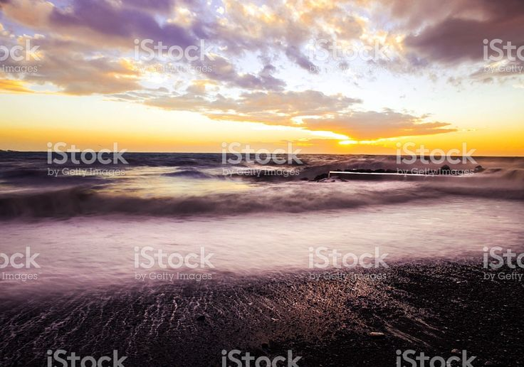 romantic sunset over rough sea foto stock royalty-free