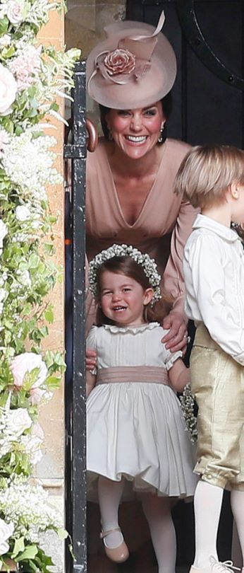 May 20, 2017: Princess Charlotte with her mother Duchess Kate, the Duchess of Cambridge, at the wedding of Pippa Middleton. Both mother and daughter looking lovely. At St Marks Church, Berkshire.