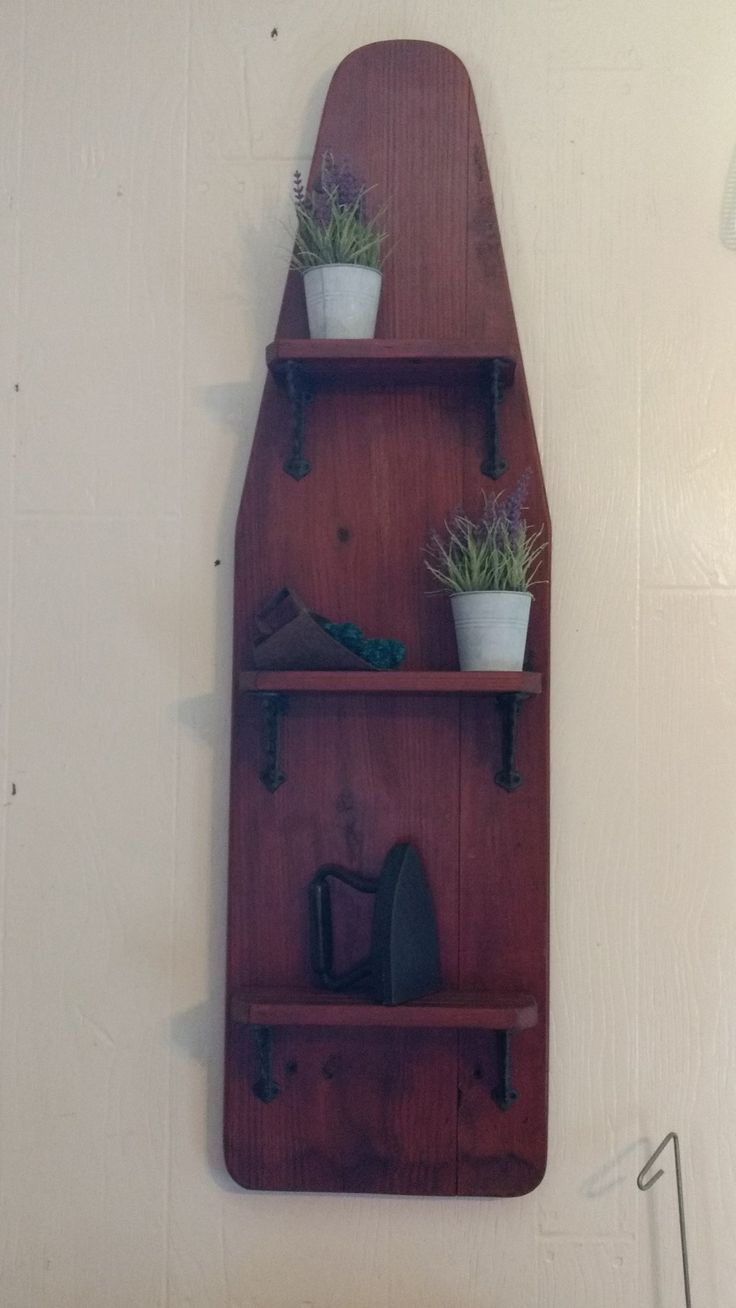 I made this from a vintage ironing board. I took it apart, glued the legs together, cut them to fit for the shelves, sanded and stained it all and used brackets from hobby lobby. I did have to straighten the board because it was warped. I used a gunstock stain which is a red color. It turned out wonderful.