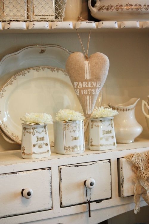 vintage canisters and some white pom flowers