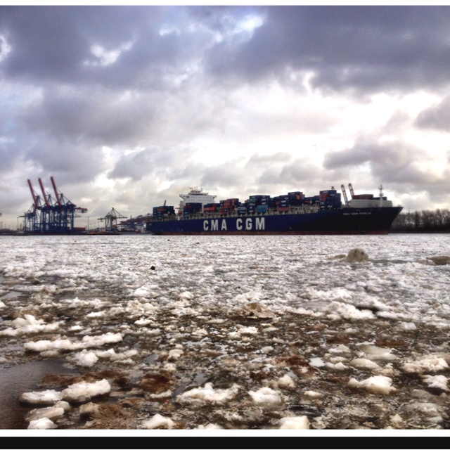 Hamburg port in winter... Big ice plates on the Elbe and container ships in the background of the picture. It was freezing cold that day and finally there was springtime;).
