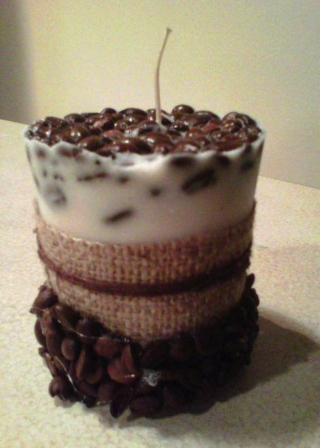 homemade coffee candle. ingredients:  cappuccino-scented wax, coffee beans, waxed wick, burlap, and hot glue.