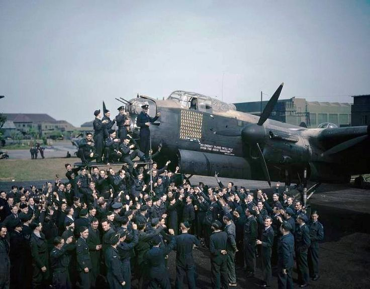 Avro Lancaster R5868 'S' Photograph of Avro Lancaster R5868 'S' for Sugar, surrounded by her crew and other members of No. 467 Squadron RAF after the aircraft had completed 100 operational flights