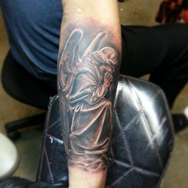 good grey ink angel tattoo on left arm - http://tattooswall.com/good-grey-ink-angel-tattoo-on-left-arm.html #angel, angel tattoos, arm, good, grey, ink, left, on, tattoo